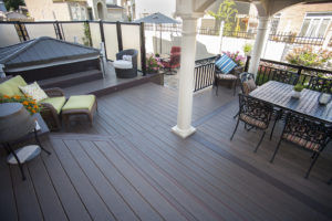 ironwood, Hickory Dickory Deck white pillars green cushions